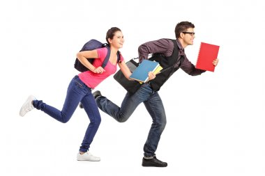 Students rushing forwards with books