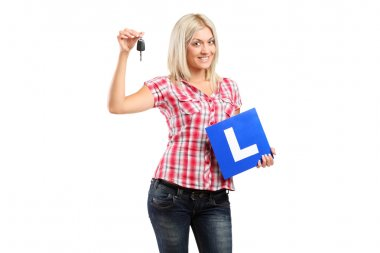 Teenager holding car key and L plate