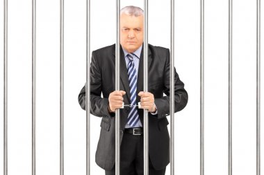 Manager in jail holding bars