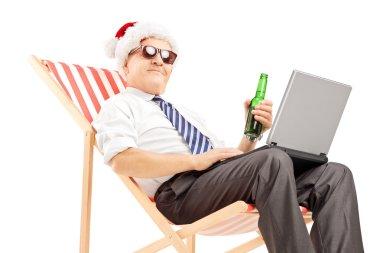 Mature santa businessman with beer