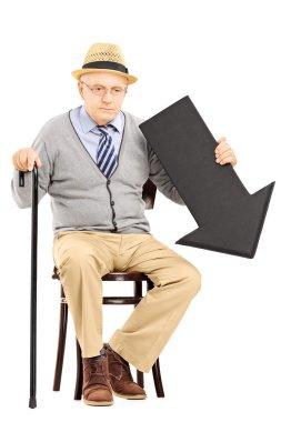 Senior man with arrow pointing down