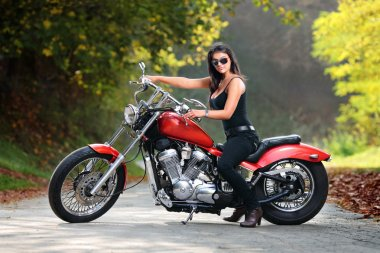 Attractive girl on motorbike