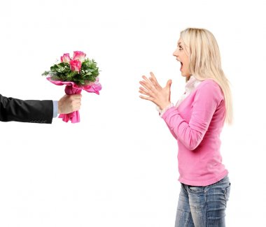 Man giving flowers and woman