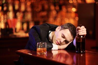 Drunk man sleeping in bar