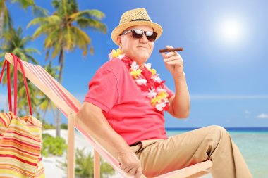 Gentleman smoking cigar and enjoying sun