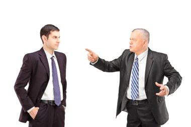Man pointing towards young man