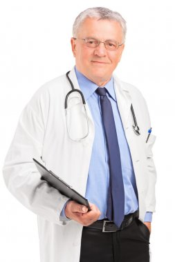 Mature doctor holding clipboard