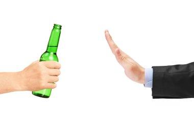 Man refusing bottle of beer