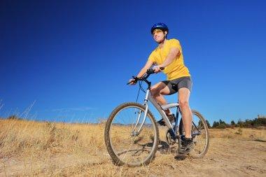 Male riding bike