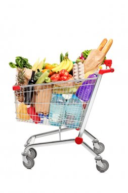 A shopping cart full with groceries isolated on white background stock vector