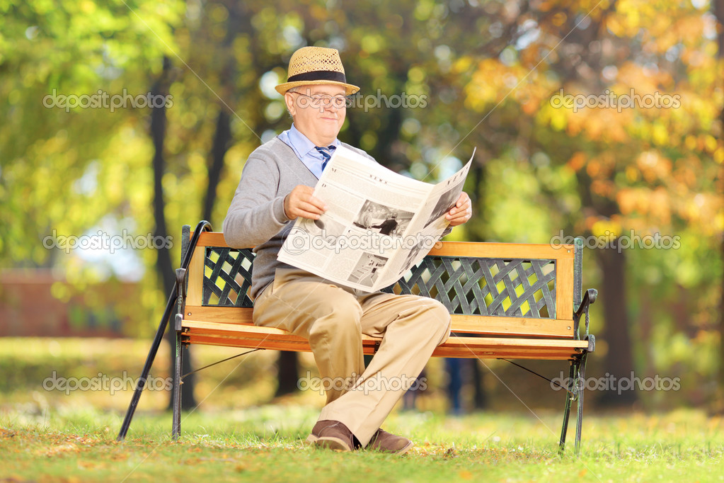 Senior gentleman reading a newspaper