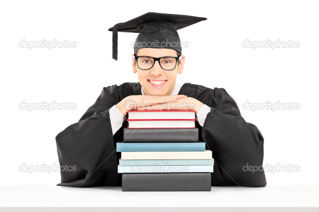 college graduate behind stack of books stock photo