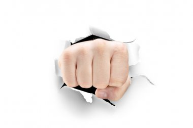 Male fist breaking through paper