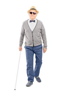 Gentleman walking with stick