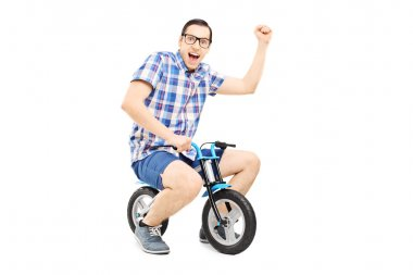 Man with raised fist riding bike