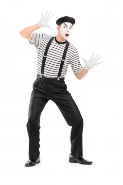 Male mime artist performing