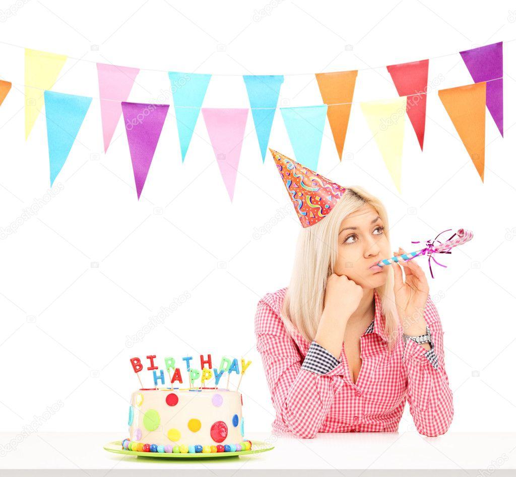 Sad birthday girl with cake