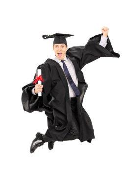 Male graduate student jumping