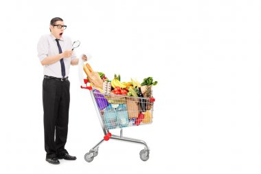 Man examining shopping bill