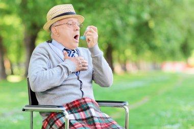 Senior man having asthma attack