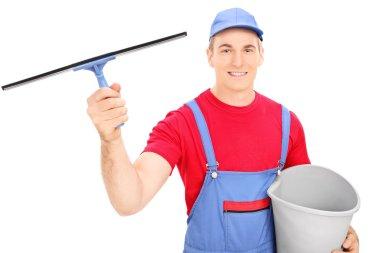 Male window cleaner holding bucket