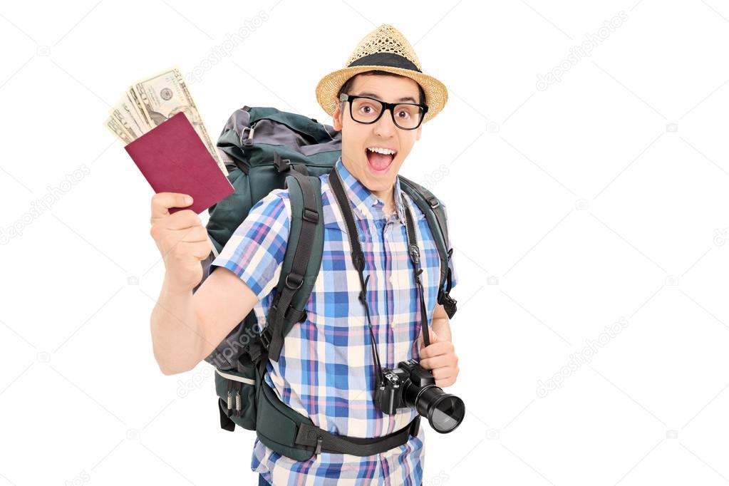 Male tourist holding his passport