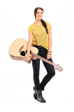 Female musician holding acoustic guitar
