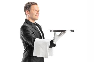 Male waiter holding tray