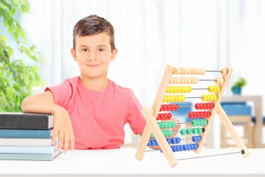Boy counting on abacus