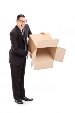 Full length portrait of a businessman holding an empty box isolated on white background stock vector