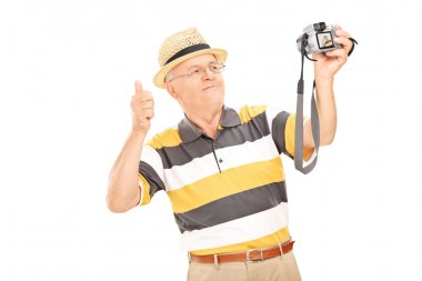 Senior gentleman taking selfie