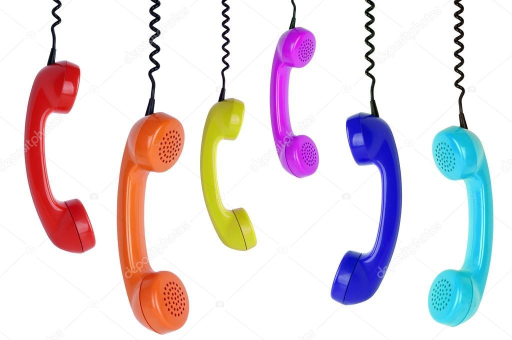 Seis telefones coloridos pendurados — Fotografia de Stock