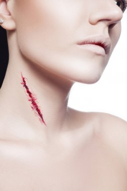 Girl with a cut on neck