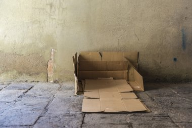 Bed made of cartons of a homeless man
