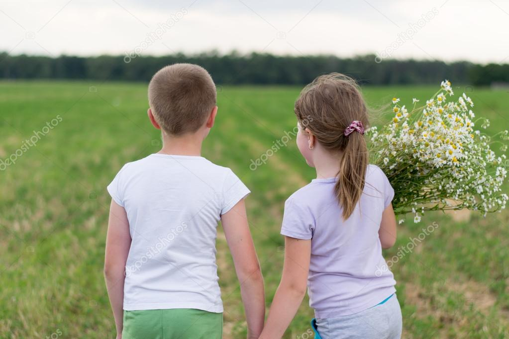 boy and girl with a bouquet of daisies