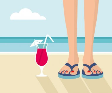 Girl on the beach with her cocktail