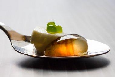 Molecular salad on metal spoon