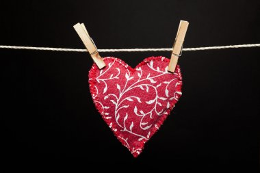 Red heart hanging on the clothesline