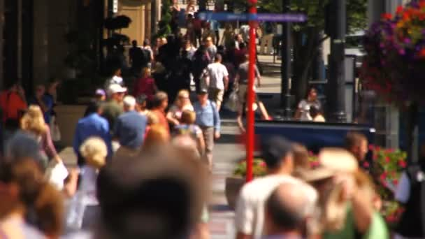 City pedestrians walking by in the city
