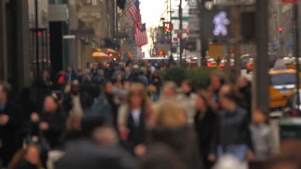 Slow motion of city pedestrians walking