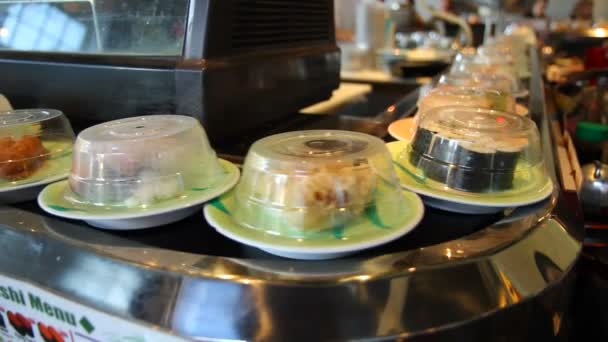 Sushi on conveyor belt