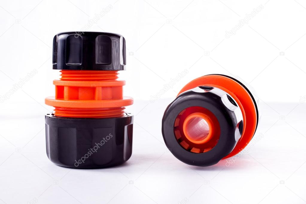 Orange adapter for connection of a garden hose with watering system
