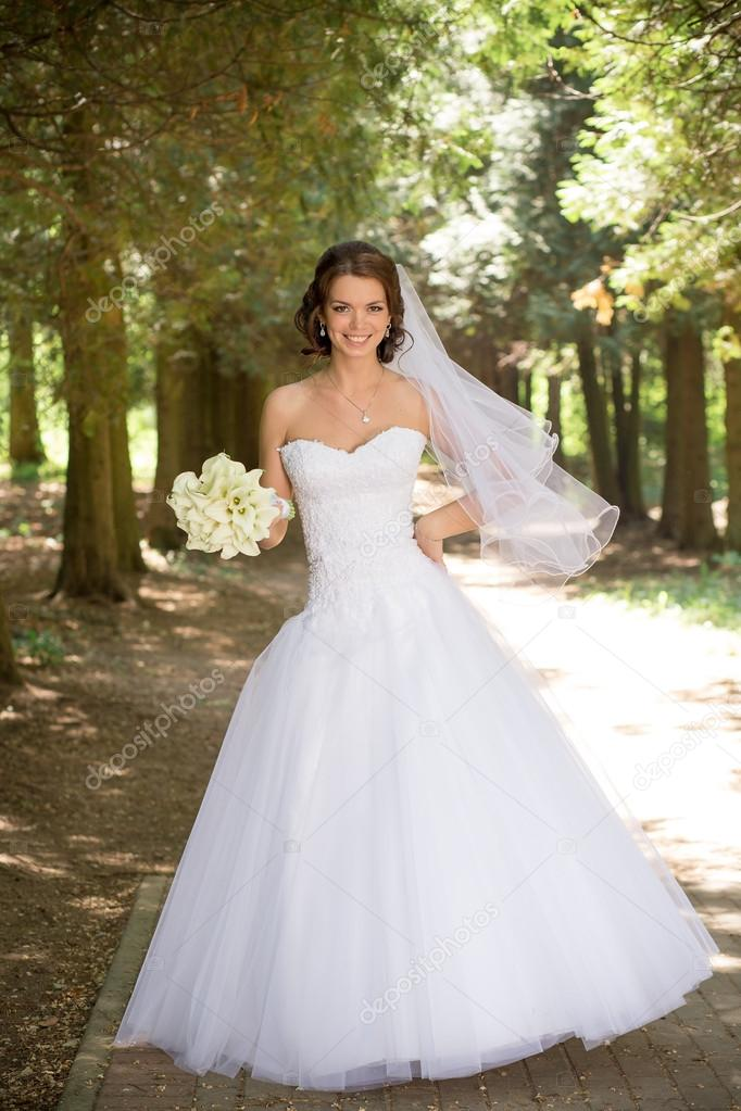 Vestido de novia con el ramo