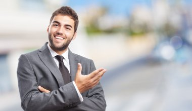 Businessman doing welcome gesture
