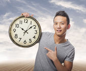 Photo Man holding clock