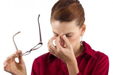 Businesswoman suffering from eyestrain