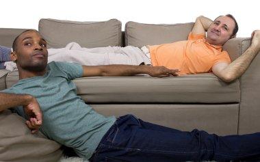 Two gay lovers relaxing in the livingroom