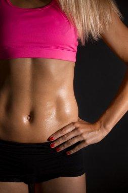 Sweaty female abdominal muscles