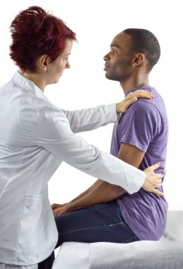 Therapist consulting male about posture