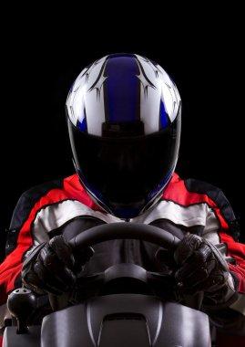 Racer wearing racing suit and helmet